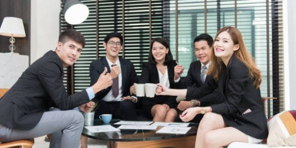 young business professionals having a meeting in office,Workers discussing new business plan together in a conference room.